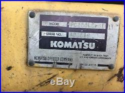1994 Komatsu PC200LC-6 Excavator with a Labounty Grapple
