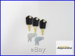 3 Caterpillar keys & 2 Caterpillar isolater keys. Cat excavator dozer