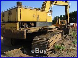 Cat 235B excavator with grapple