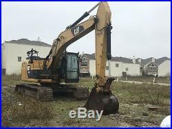 Excavators Cat 320E 2014 with 4000 hours