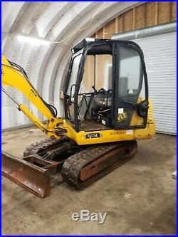 Jcb 804 mini excavator erops 2,200 hrs 2 buckets. Runs great